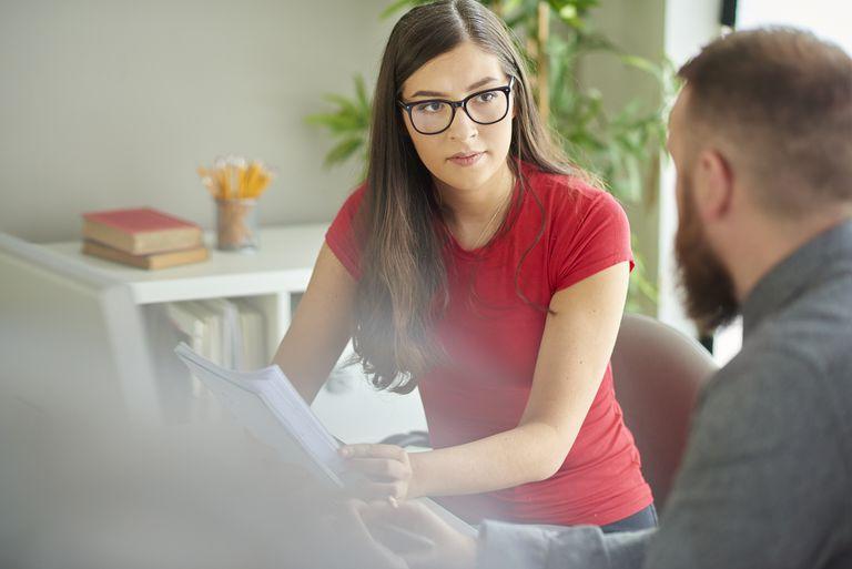 university student listening to tutor
