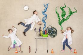 kids in lab coats playing with science