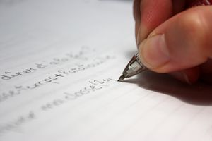 Close-Up Of Text Written On Paper