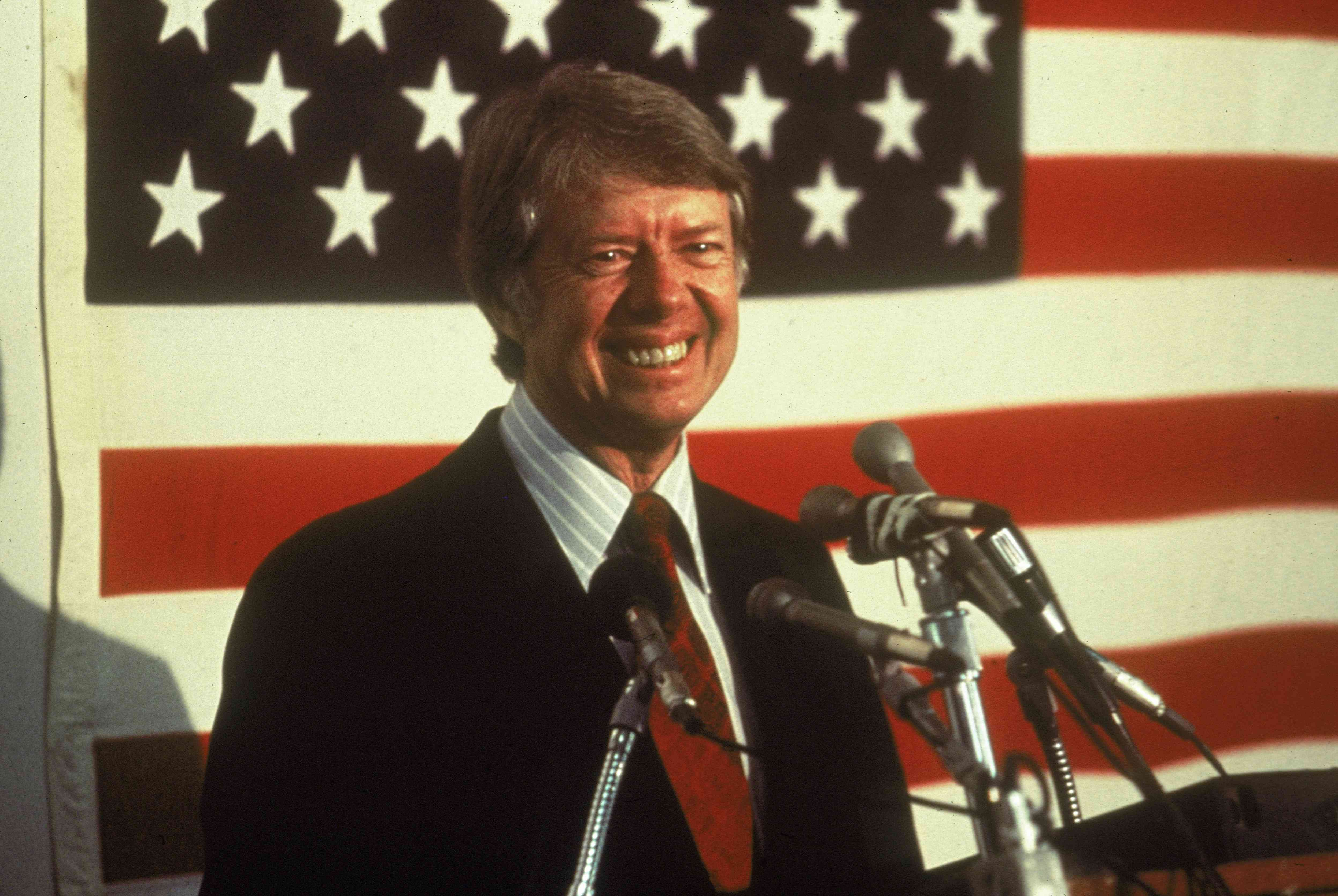 Jimmy Carter In Front Of U.S. Flag