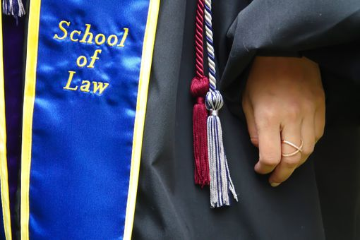 A sash for Commencement, indicating graduation from law school