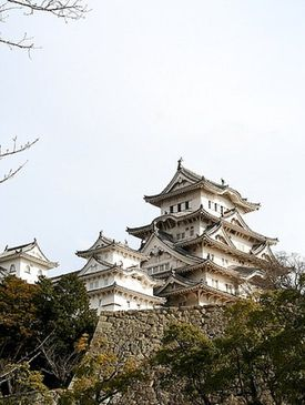Bright winter sun glints of Himeji Castle, built 1333-1346 A.D. in Hyogo Prefecture, Japan.
