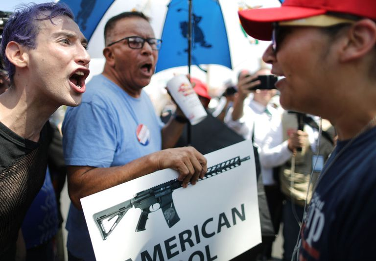 Anti-Trump protestors and a Trump supporter argue following a mass shooting which left at least 22 people dead, on August 7, 2019 in El Paso, Texas.