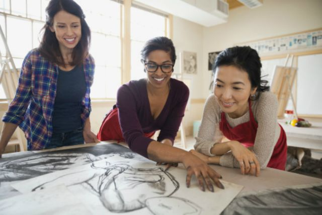 Students taking a drawing class
