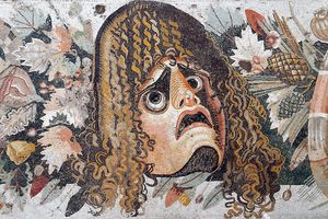 Detail of Roman mosaic depicting tragic mask with leaves and fruit