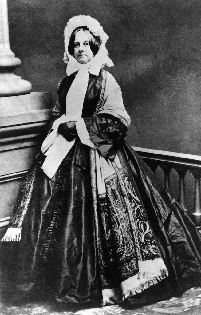 Portrait of Abigail Powers Filmore standing next to pillar.