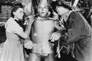 Dorothy and the Scarecrow oiling the Tin man
