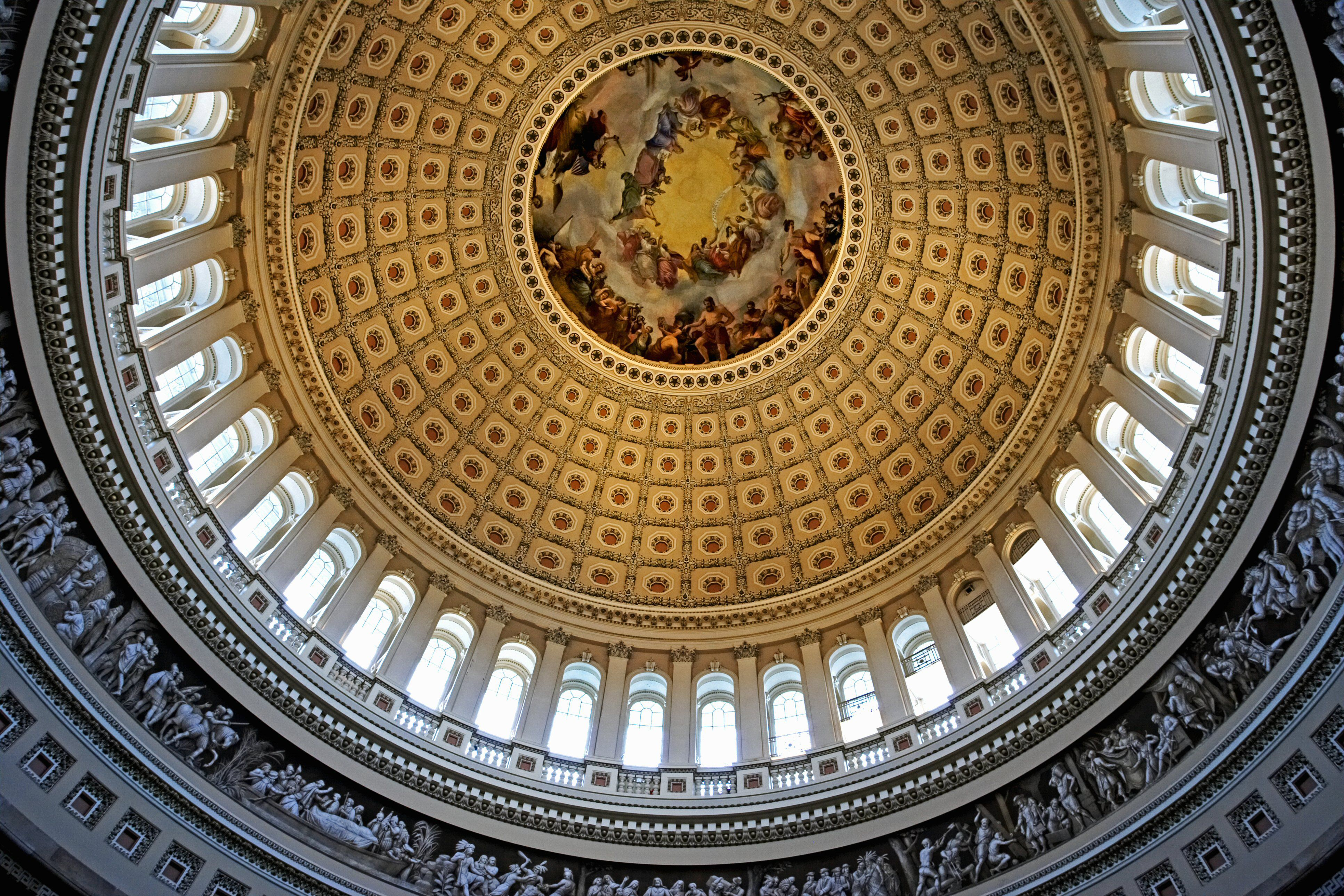 Interior view from below dome, round, windows around the bottom, coffered ceiling with mural in round center top