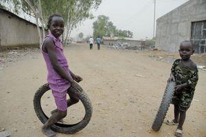 Kids play on a street in Juba, South Sudan