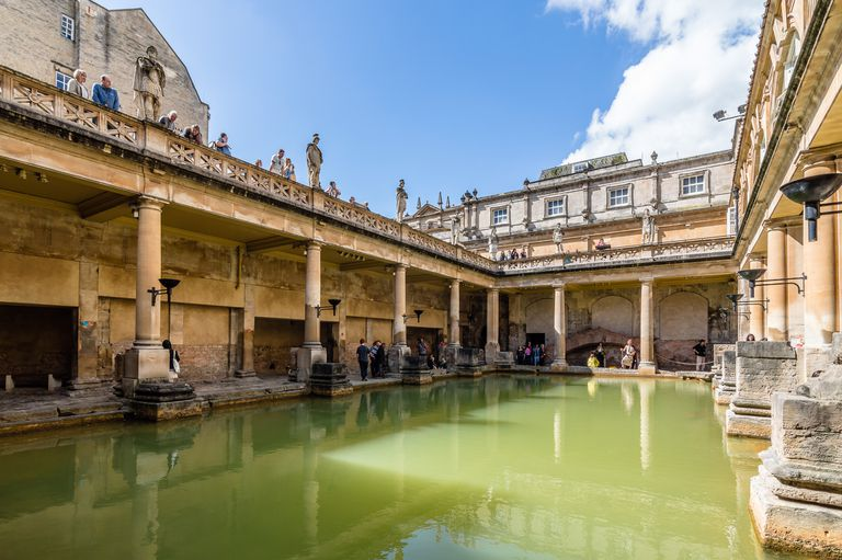 Tourist At Roman Baths On Sunny Day Against Sky