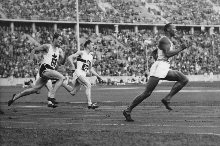 U.S. sprinter Jesse Owens running ahead of two other runners