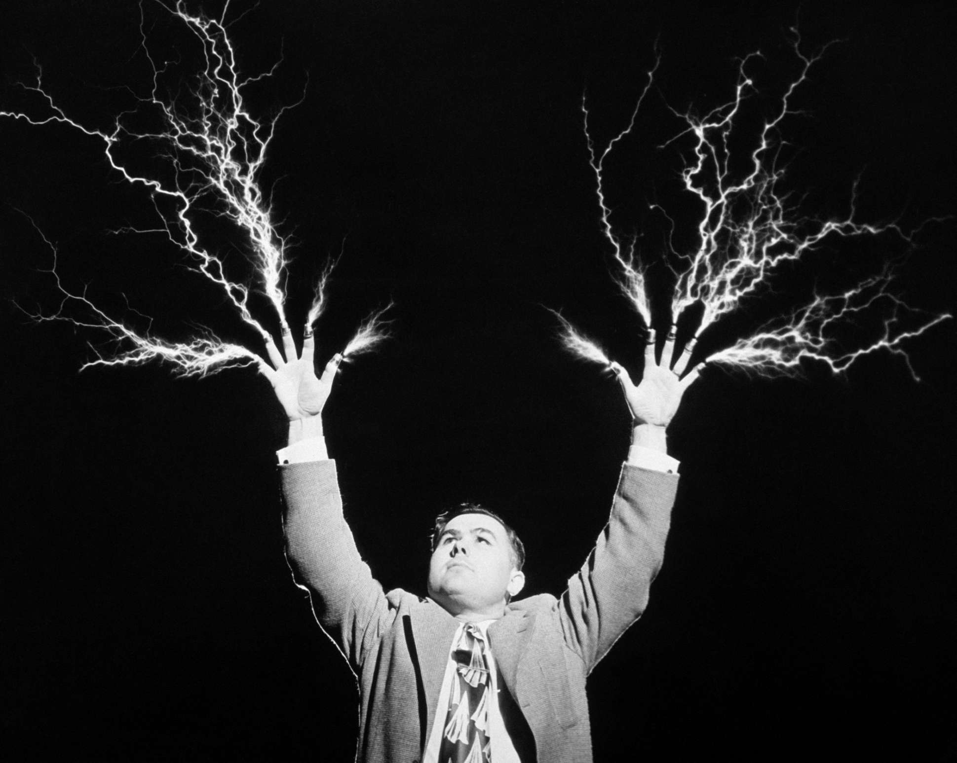This mad scientist is shooting lightning from his fingertips.