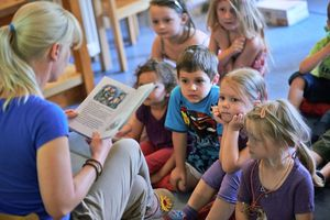 Teacher in reads to a rapt audience during classroom storytime