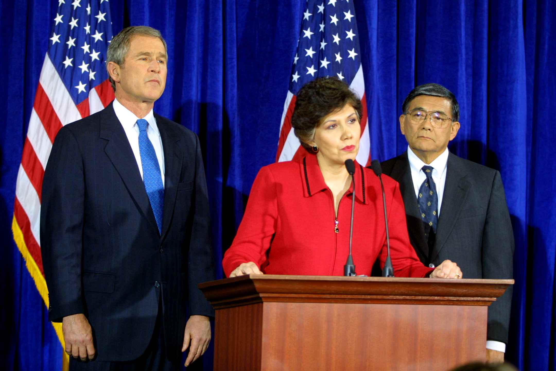 Linda Chavez at Lectern with U.S. President-elect George W. Bush