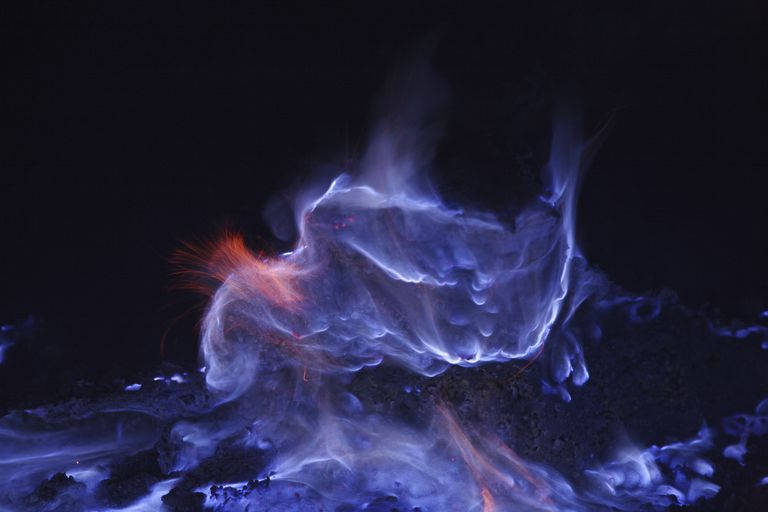 "This ""blue lava"" from the Kawah Ijen volcano is really burning sulfur."