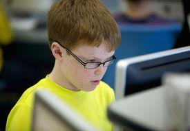 Sixth grader in computer lab at school
