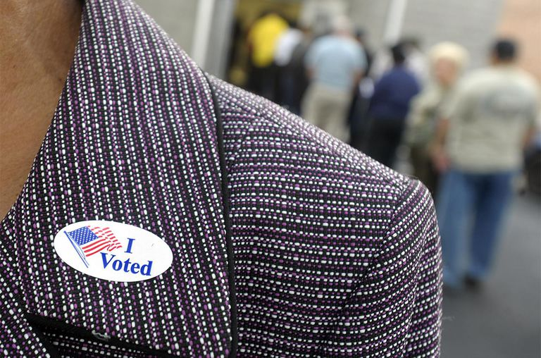 A voter displays their 'I Voted' sticker on their lapel