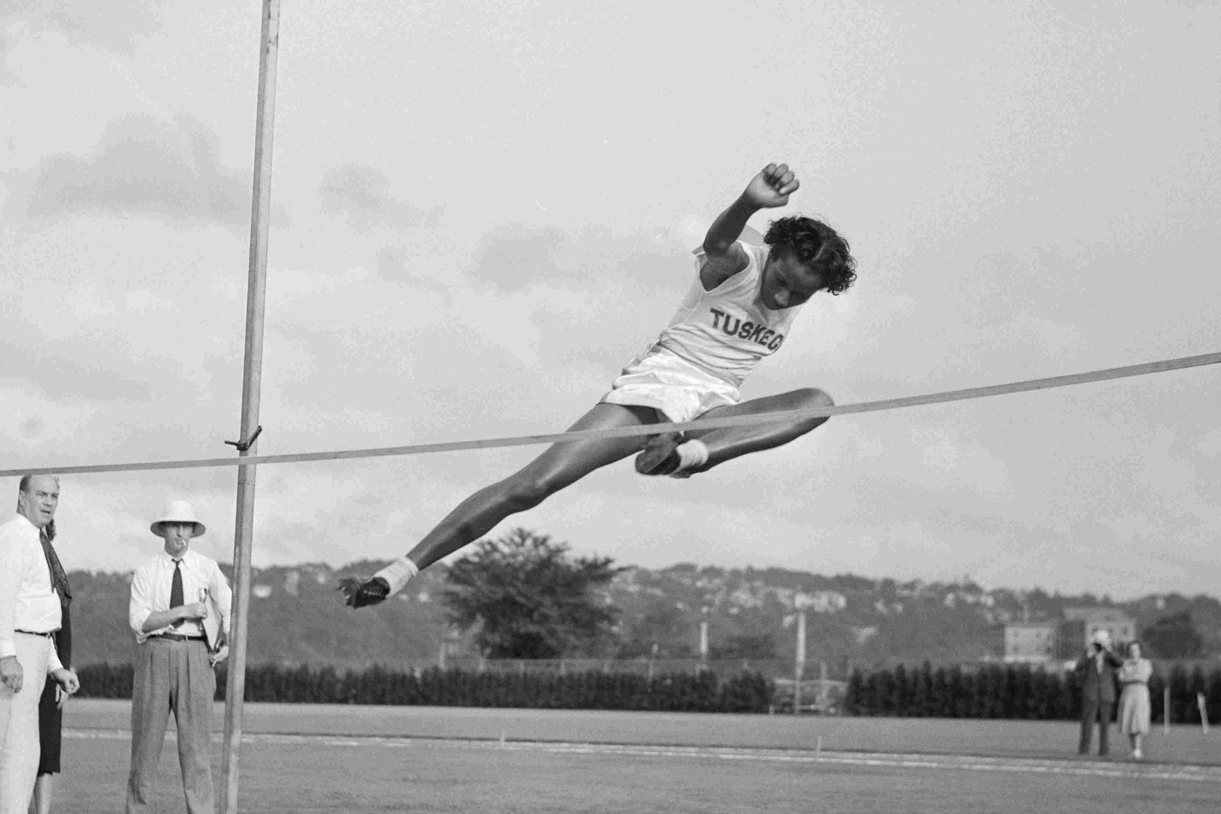 Alice Coachman of Tuskegee Institute Club on the High Jump