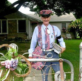 US Postal Service letter carrier decked out for Independence Day