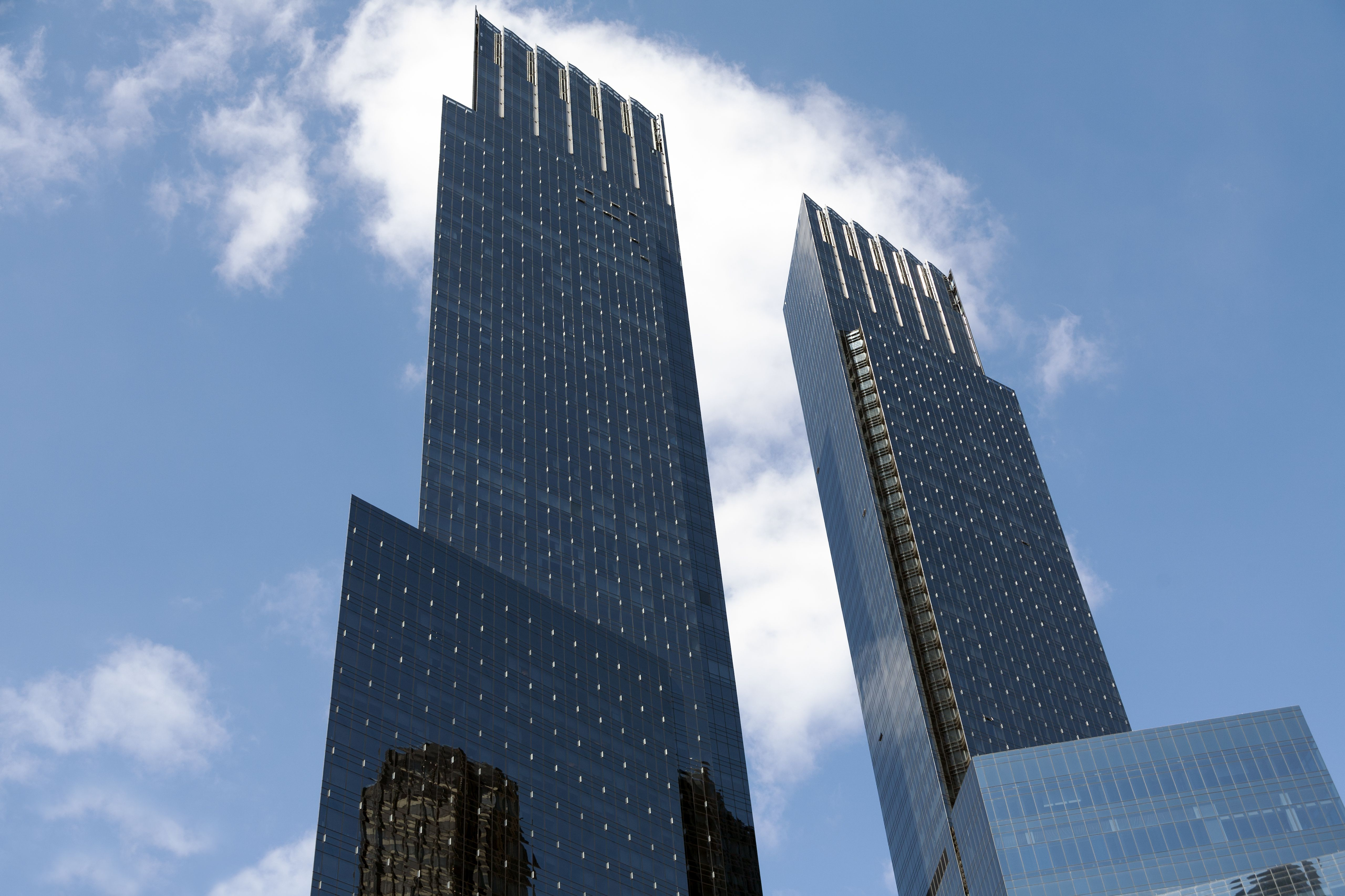 two rectangular skyscraper towers looking like large digital connectors at the top