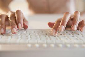 Hands typing, closeup