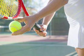 Close up of female tennis player preparing to serve