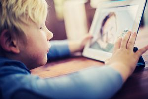 Kid Talking to Mom on Tablet