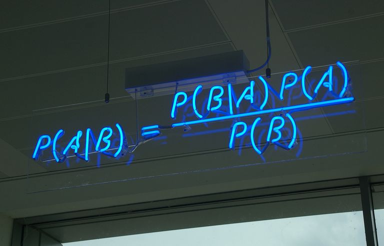 Bayes' Theorem is presented in neon lights at the offices of Autonomy in Cambridge.