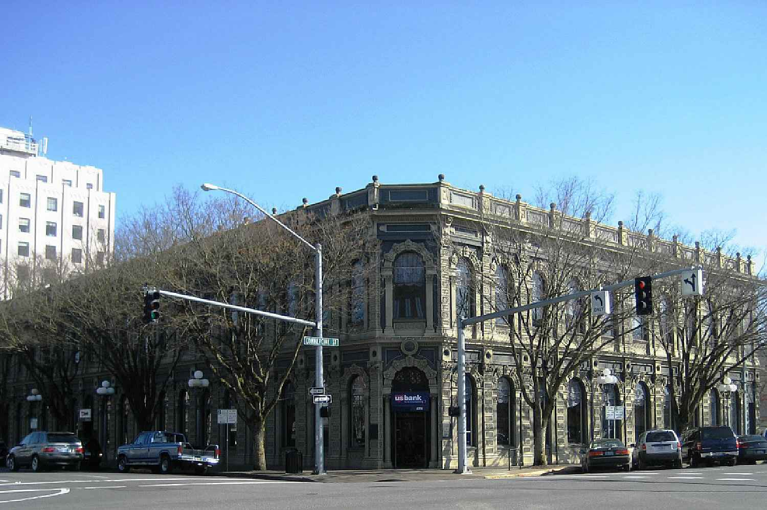 Cast-iron facade of corner building, entrance at the corner, two stories with very large window openings