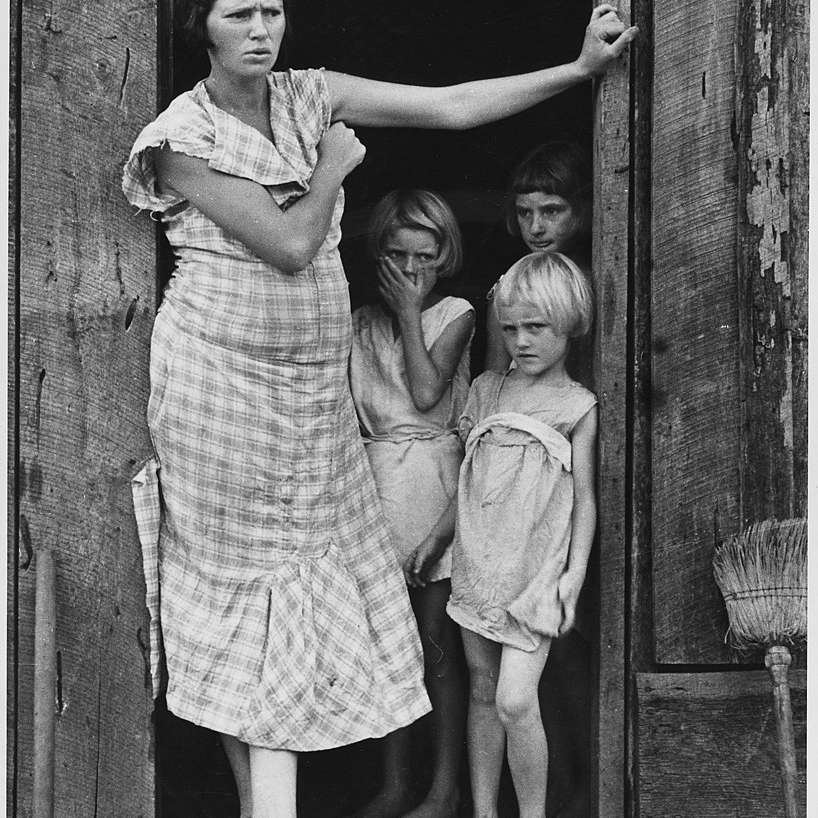 Wife and children of a sharecropper during the Great Depression.