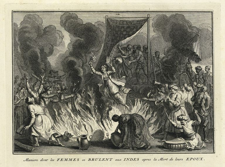 A widow is thrown onto her husband's pyre