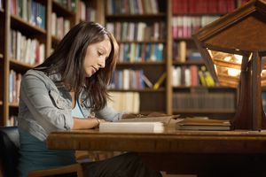 Female Student in Library Reading