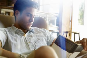 Man reading in cafe
