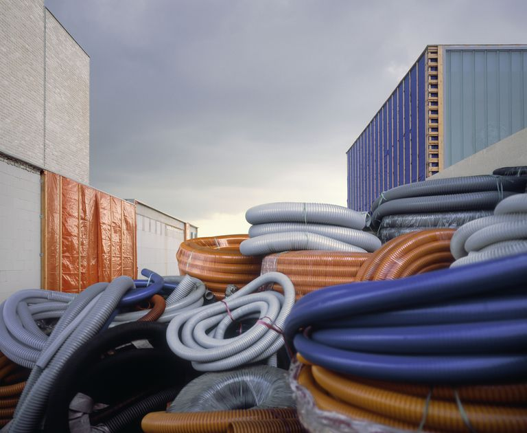 Large collection of colorful tubing at construction site