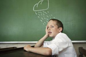 Gloomy student in class