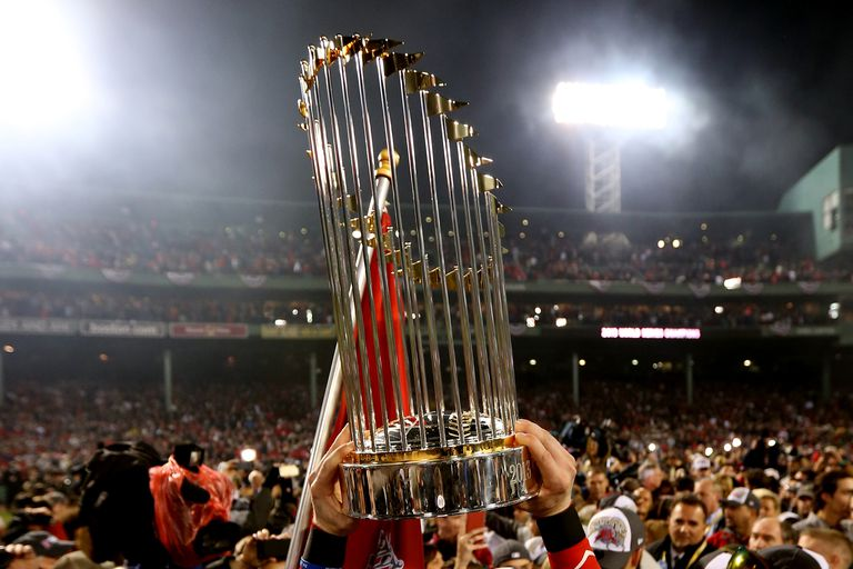 The Boston Red Sox celebrate with the World Series trophy after defeating the St. Louis Cardinals at Fenway Park in 2013.
