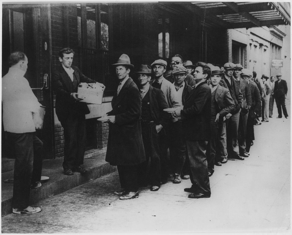 Long line of people waiting to be fed in breadlines in New York City during the Great Depression