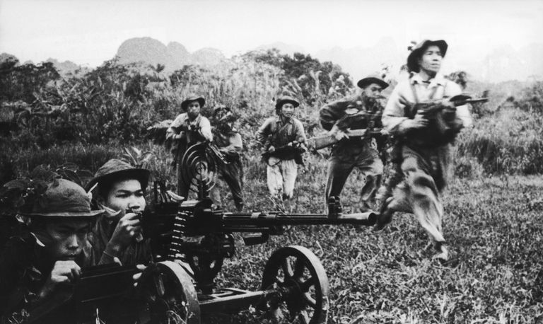 Black and white photo of the Viet Cong fighting during the Vietnam War in 1968.