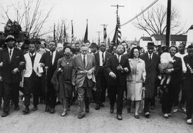 Martin Luther King Marches with civilians for civil rights.