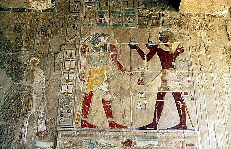Pharaoh Hatshepsut making an offering to Horus.