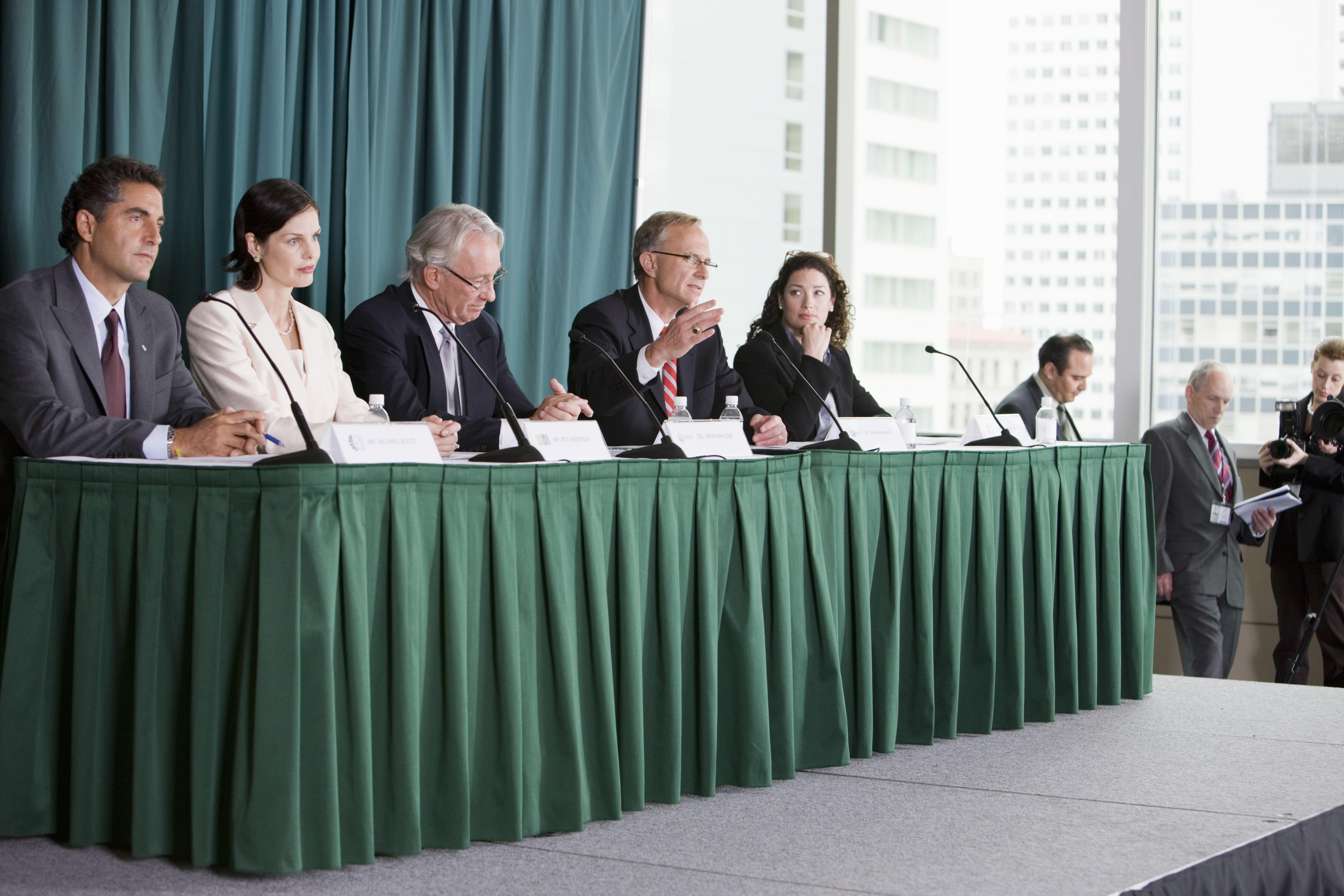 Business people on seminar panel