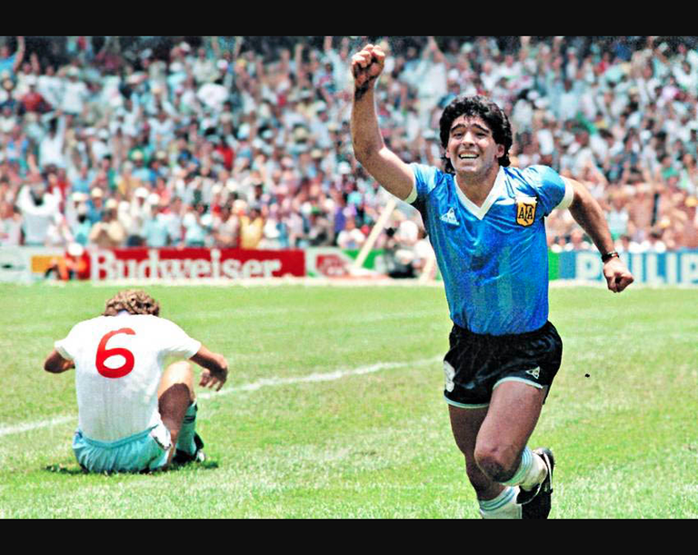 Diego Maradona celebrating his second goal scored to England during the 1986 FIFA World Cup.