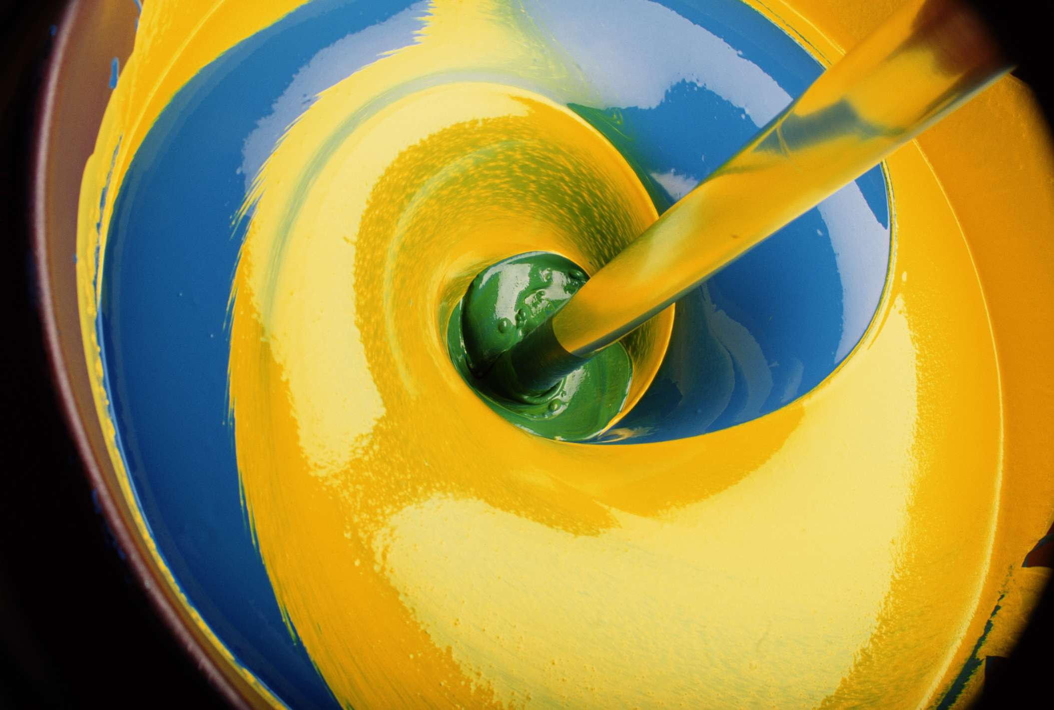 Swirl Of Yellow And Blue Paint Producing Green Close Up