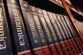 Close up of an Encyclopedia Brittanica set on a bookshelf