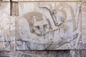 Bas Relief Carving of Lion Hunting a Bull in Persepolis, Shiraz, Fars Province, Iran.