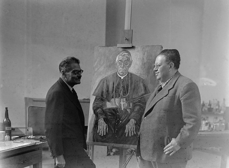 Jose Clemente Orozco and Diego Rivera pose by a painting on an easel