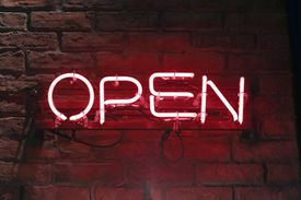 'Open' neon sign at night