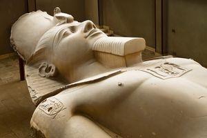 A limestone statue of Ramses II, lying on display