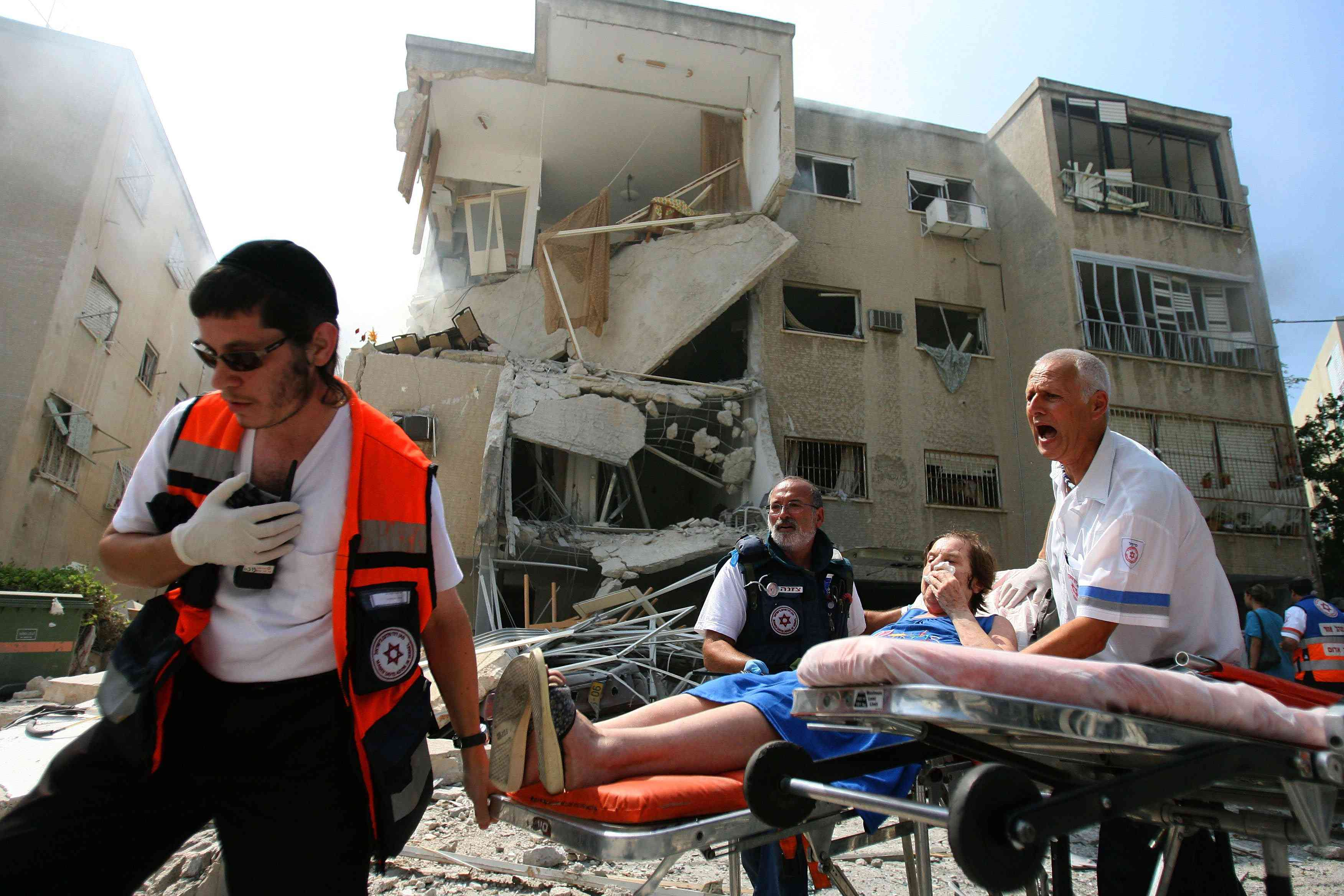 Wounded are taken away after a Hezbollah missile strike July 17, 2006 in the northern Israeli city of Haifa. Uriel Sinai/Getty Images