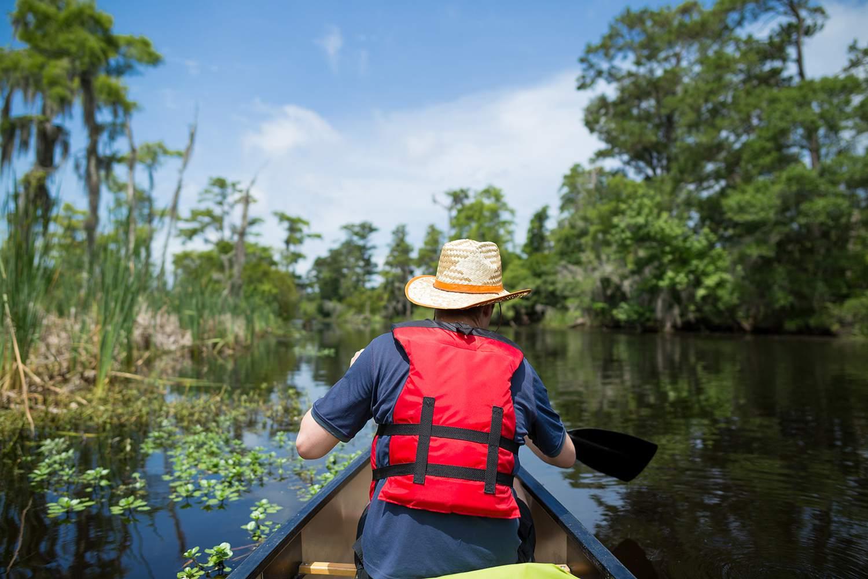 Man canoeing through Lake Pontchartrain in Louisiana